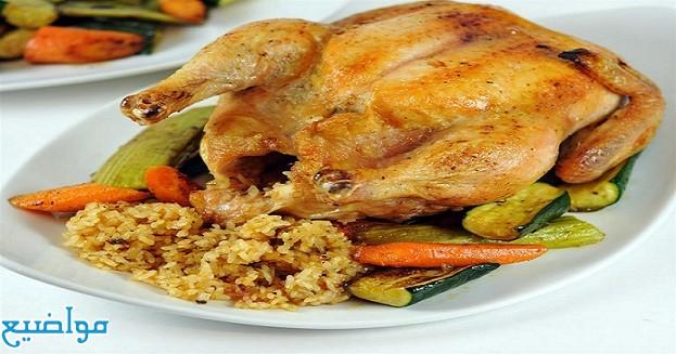الدجاج المحشي طريقة عمل الدجاج المحشي بالأرز والخضار